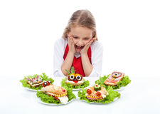 Little girl with creative party sandwiches Royalty Free Stock Photo
