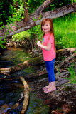 Little Girl by Creek stock photo