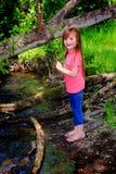 Little Girl by Creek Stock Photo