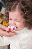 The little girl cries. Stock Photo
