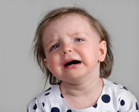 THE LITTLE GIRL CRIES Royalty Free Stock Photo
