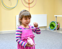 The little girl cries in kindergarten Stock Photo