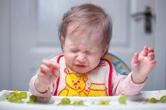 Little girl croaks from gooseberries Stock Image