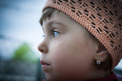 Little girl  with crocheted pink hat. Close-up (portrait) from  little girl with  a pink  crocheted hat.Germany Stock Images
