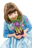 Little girl with crocus spring Stock Image