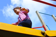 Little girl cross a playground bridge Royalty Free Stock Images