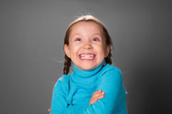 Little girl crossed hands on the chest. Royalty Free Stock Photo