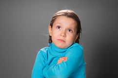 Little girl crossed hands on the chest. Royalty Free Stock Photography