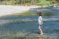 Little girl crossing a river Royalty Free Stock Image