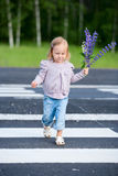 Little girl crossing road Royalty Free Stock Photo