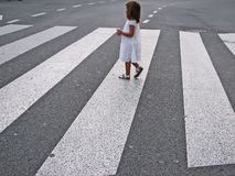 Little girl crossing street Royalty Free Stock Photos