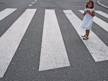 Little girl crossing street Stock Photography