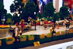 A little girl crossing the street. A lively avenue with dolls and model cars in the exhibition in IFC mall , shanghai Royalty Free Stock Images