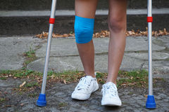 Little girl with crutches at the stair Royalty Free Stock Images