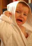 Little girl cry in dressing-gown Stock Photos