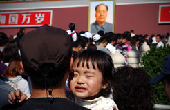 Little Girl Crying. In tiananm square during the National Day Holiday.National Day, tens of thousands of visitors flock to Tiananmen Square, people move slowly Stock Images