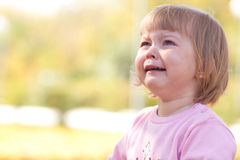 Little girl crying on the autumn forest Stock Photography