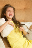 Little girl crying on a chair Royalty Free Stock Photo