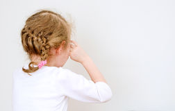 Little girl crying. In the corner Stock Images