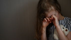 Little girl crying in the corner. stock footage