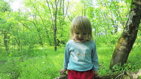 Little girl crying in forest stock footage