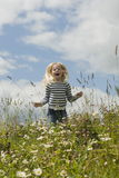 Little girl crying on meadow. In summer Stock Photos