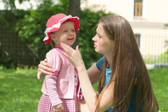Little girl crying in mothers arm Stock Photography