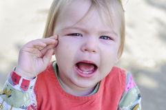 Little girl crying and offended. Stock Photos