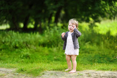 Little girl crying in a park Stock Images