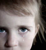 Little Girl Crying with Tears. Portrait of little girl crying with tears rolling down her cheeks Stock Photo
