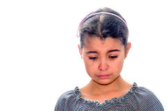 Little girl crying with tears rolling down her cheeks isolated o Stock Image