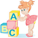 Little girl with cubes Royalty Free Stock Image