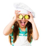 Little girl with cucumber Stock Photo