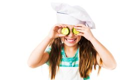 Little girl with cucumber royalty free stock image