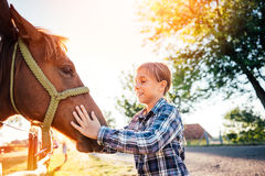 Little girl cuddle horse royalty free stock image