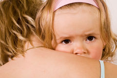 Little girl cuddling with her mother - closeup Royalty Free Stock Images