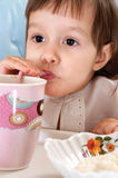 Little girl with cup Stock Image