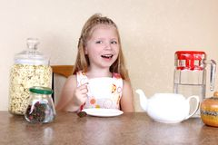 Little girl with cup of hot drink Stock Image