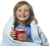Little girl with a cup of hot tea Royalty Free Stock Photos