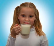 Little girl with a cup of milk Royalty Free Stock Photos