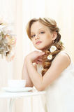 Little girl with cup of tea Stock Photo