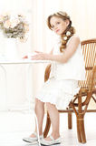 Little girl with cup of tea. Beautiful little girl sitting in cafe and drinking tea Royalty Free Stock Photography