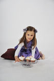 Little girl with Cupcakes Stock Photography