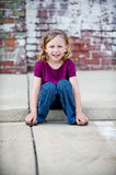 Little Girl on Curb Stock Photography