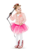 Little girl with curling iron. Stock Image
