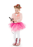 Little girl with curling iron. Stock Photography