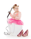 Little girl with curling iron. Stock Photos