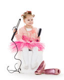 Little girl with curling iron. Royalty Free Stock Photos