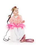 Little girl with curling iron. Royalty Free Stock Photo