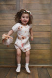 Little girl with curly hair, having fun while posing Stock Photography